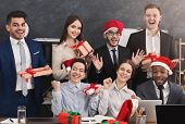 Happy Business Team Enjoying Christmas Party In Office, Holding Gift Boxes After Secret Santa Game,  poster