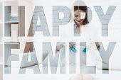 Happy Family. Happy And Smiling Brunette Girl. Young Pregnant Mother. Mother Holding Baby Shoes. Gir poster