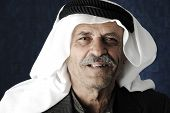 stock photo of arab man  - Mature Arabic man with traditional clothes - JPG