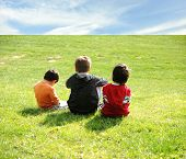 pic of children playing  - Happy children in grass - JPG