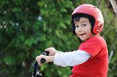 stock photo of young boy  - Young boy riding bicycle - JPG