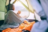 Alone Woman Drinks Hot Tea In Camping Tent And Enjoy With Autumn Evening In Mountain Valley poster