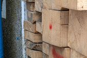 Pine Wood Timber Stack Of Natural Rough Wooden Boards On Building Site. Industrial Timber Building M poster
