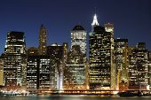 stock photo of high-rise  - Lower Manhattan at night from the Brooklyn Heights Promenade - JPG
