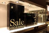 image of box-end  - two boxes for sale AD in a store window - JPG