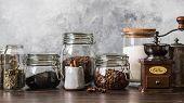 Various Ingredients For Making Hot Drinks - Coffee, Herbal Tea, Black Tea. Glass Jars With Coffee Be poster