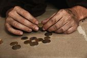 Poor Homeless Man Counting Coins On Floor, Focus On Hands poster