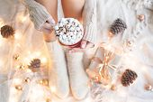 Woman Hands Holding A Cup Of Coffee. Cozy Winter Concept. Winter Hot Drink. Hot Chocolate Or Cocoa W poster