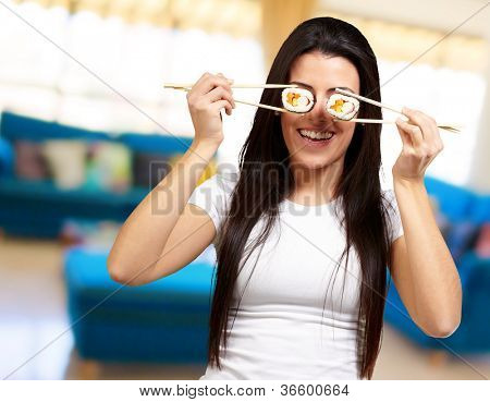 Portrait Of A Female Holding Sushi Roll, Indoor