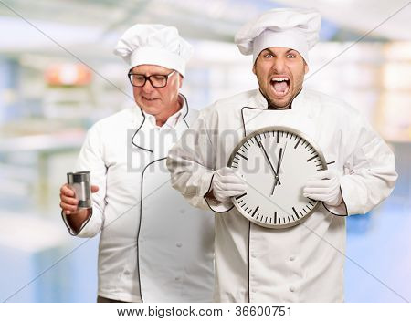Portrait Of Angry Chef Holding Clock, Indoor