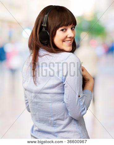 Happy Woman Wearing Headphone, Outdoor