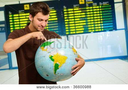 Man Pointing On Globe, Indoor