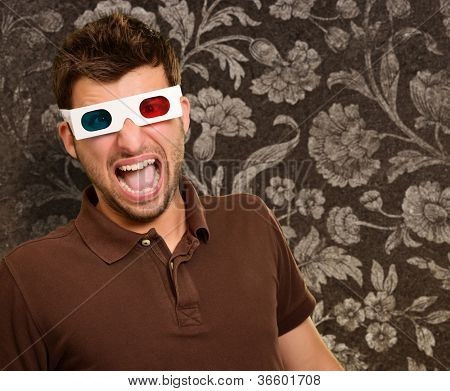 Portrait Of A Young Man Wearing A Retro Glasses On A Wall Paper