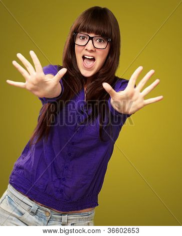 Woman Stopping With Hands Isolated On Green Background