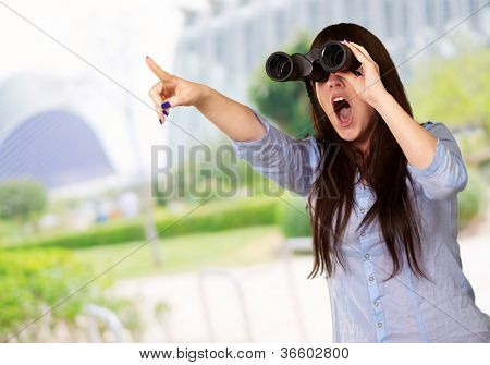 Portrait Of A Young Woman Looking Through Binoculars, Outdoor