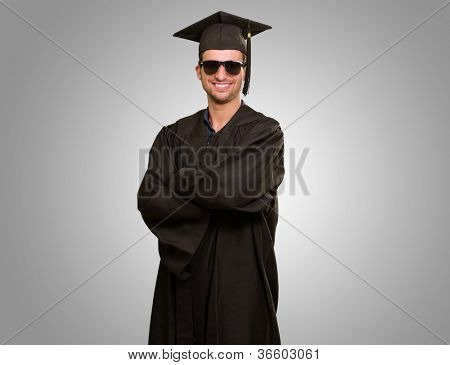 Graduate Man With Hands Folded Isolated On gray Background