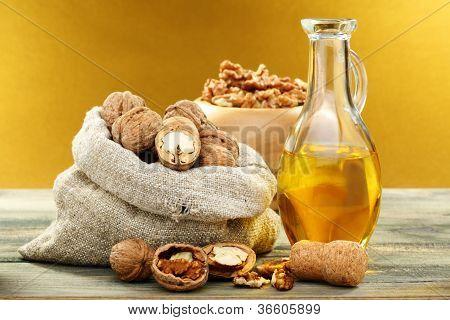 Walnut Oil In Bottle And Nuts.