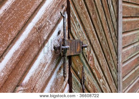 Old Barn Wall With Double Doors, Closeup Of The Lock