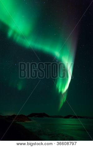 Northern Lights Over Frozen Lake Myvatn In Iceland