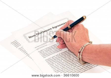 Woman Signing NDA Form