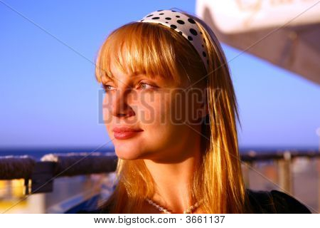 Beautiful Blond Girl Look At Sunset