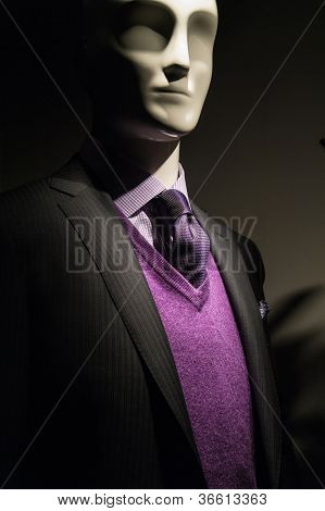Mannequin In Dark Jacket  With Purple Sweater And Tie