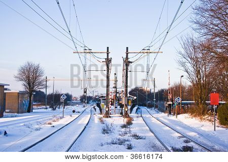 Railroad And Railwaystation In Winter With Snow