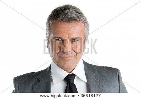 Closeup portrait of mature businessman looking at camera with satisfaction, isolated on white background