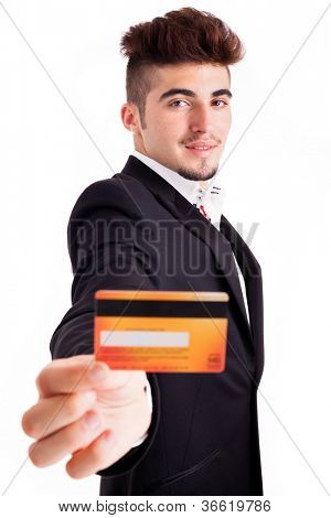 Young business man showing credit card - isolated on white