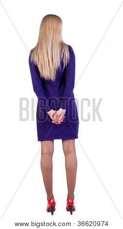 back view of standing beautiful  business woman. Young blonde businesswoman in violet dress . Rear view. Isolated over white background.
