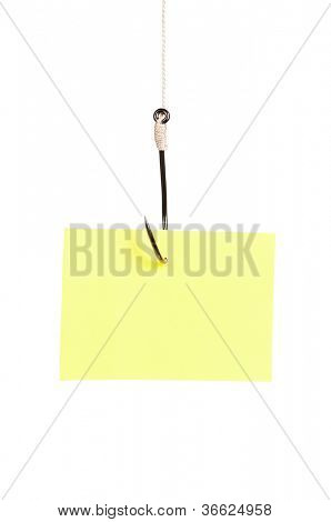 Fish hook with blank note paper isolated on white background