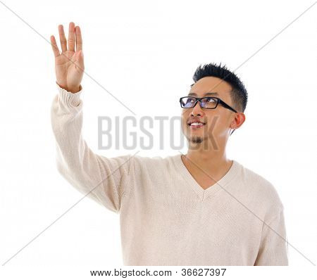 Asian man hand touching on transparent virtual screen, space for text/button