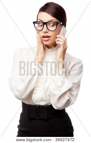 Strict woman in large glasses with a cell phone, isolated on white background