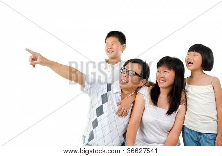Asian family, father pointing to side over white background