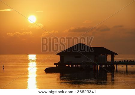 Sunset With Water Bungalow In The Indian Ocean, Maldives