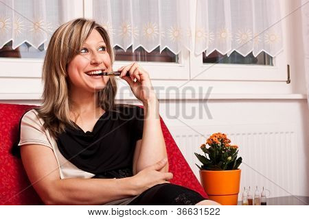 Woman Sitting On Couch Evaporated Electric Cigarette