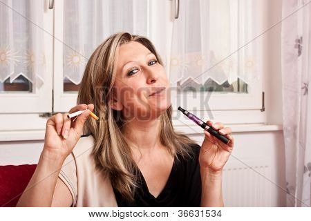 Blonde Woman Opts For Electronic Cigarette