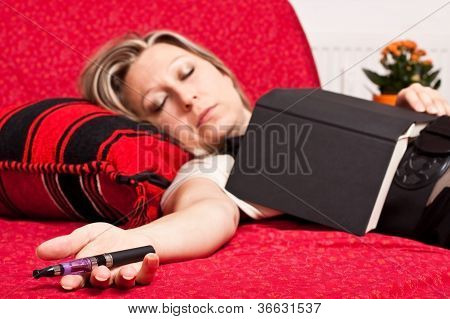 Blond Woman Asleep With E-cigarette