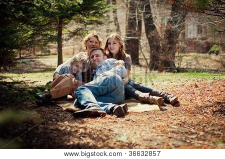 Family Resting In The Forest