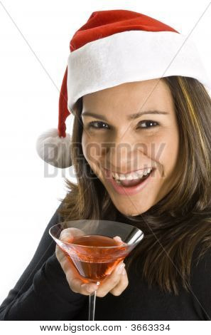 Hispanic Woman Wearing Santa Hat And Holding A Martini
