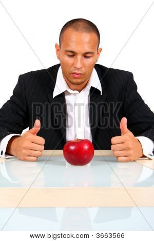 Young Business Man Thinking With Apple
