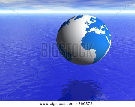 Planeta tierra globo sobre azul mar y cielo nublado