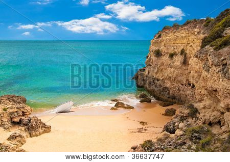 Empty beach and cliff tops on Praia de  Marinha Portugal