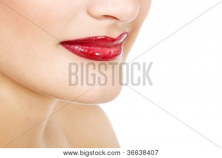 Beautiful lips with smile of young gorgeous fresh woman with vivid red lipstick, face detail. Isolated over white background