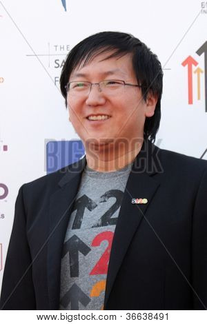 LOS ANGELES - SEP 7:  Masi Oka arrives at the 2012 Stand Up To Cancer Benefit at Shrine on September 7, 2012 in Los Angeles, CA