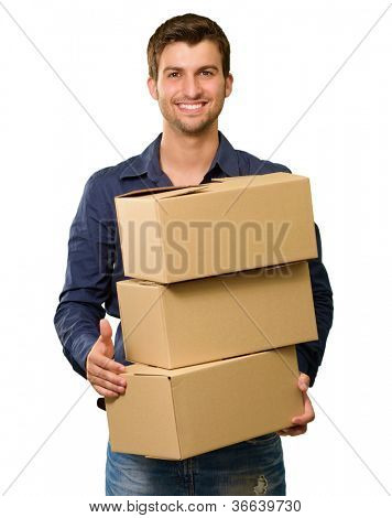 A Young Man Holding A Stack Of Cardboard Boxes On White Background