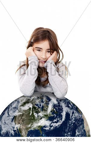 Portrait of a little girl with a small planet earth beneath her, isolated on white background