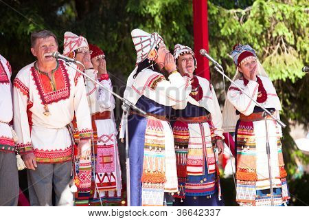 VINNICI, LENINGRAD REGION, RUSSIA - JUNE 10: Local people sing during celebrate the annual holiday Vepsian national culture Tree of Life (vepssk.Elo-pu), June 10, 2012 in the village Vinnici, Russia.