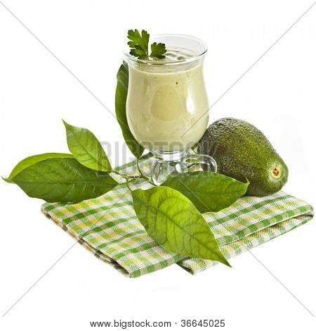 Avocado smoothie on kitchen napkin  isolated on white background