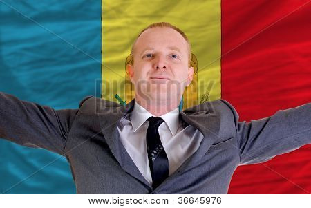 Happy Businessman Because Of Profitable Investment In Moldova Standing Near Flag